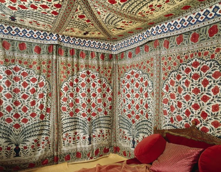 The Sultans Tipu's gloriously decorative tent, in the Clive Museum at Powis Castle. It is patterned with red flowers and green leaves against white. POW.CLIVE.T.1